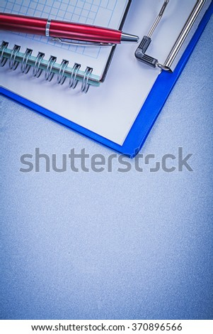 Red ball-point pen checked copybook notepad office concept. - stock photo