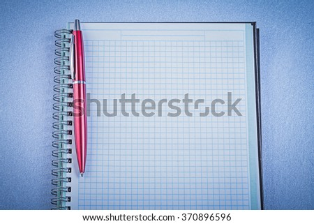 Red ball-point pen checked notepad office concept. - stock photo