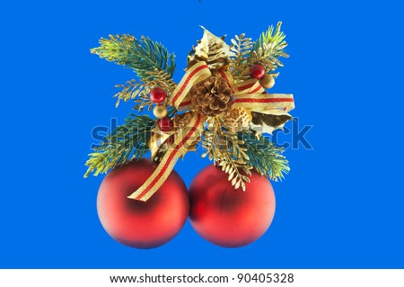 red balls, cone spruce, fir and sprigs to decorate for Christmas against a blue background - stock photo