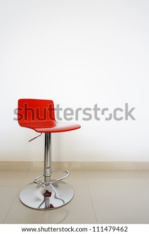 Red bar stool isolated onto white background. - stock photo