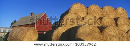 Red Barn and Haystacks - stock photo