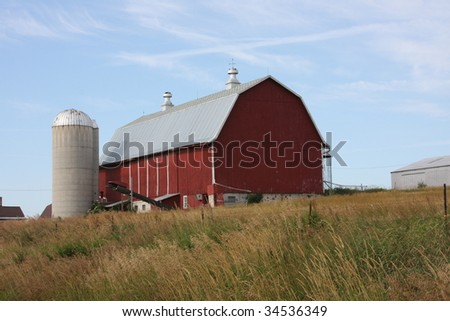 red barn and silo in Wisconsin - stock photo