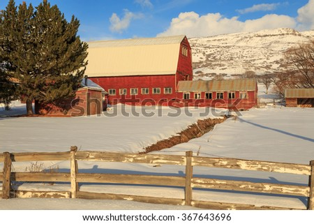 Red barn and wooden fence, Utah, USA. - stock photo