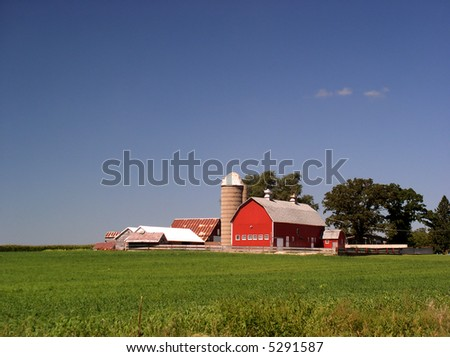 Red Barn brightens the farm - stock photo