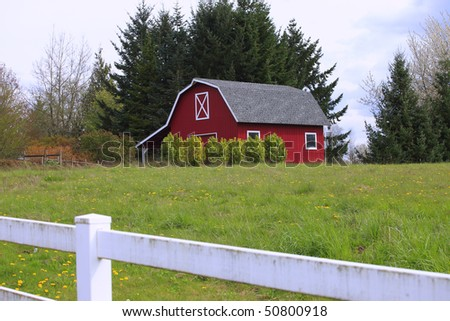Red barn-house in a country. - stock photo
