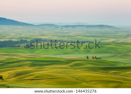Red barn in beautiful landscape of Palouse, WA - stock photo