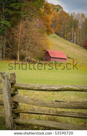 Red barn in the American mountains in the fall - stock photo