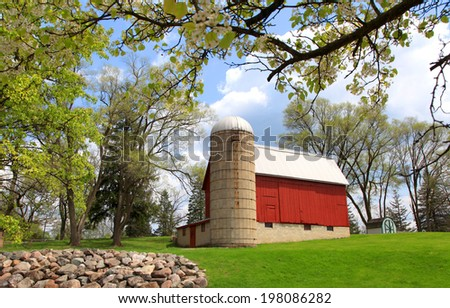 Red barn in the spring time  - stock photo