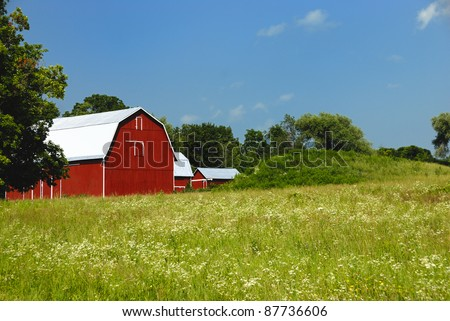 Red barn in upper New York state - stock photo