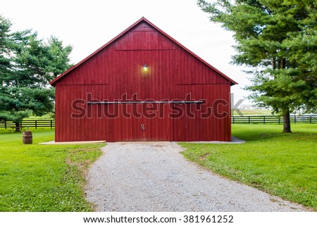 Red barn on countryside. - stock photo