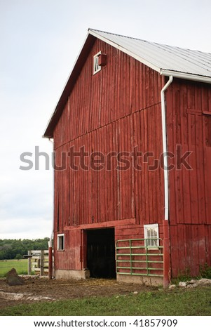 Red Barn. Vertical format. - stock photo