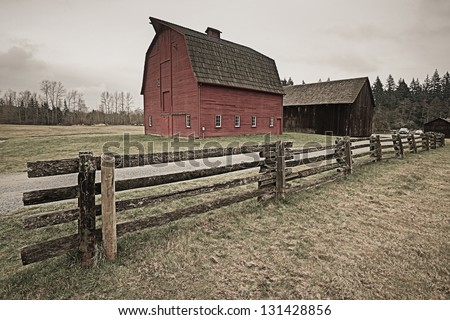 Red barn with fence - stock photo