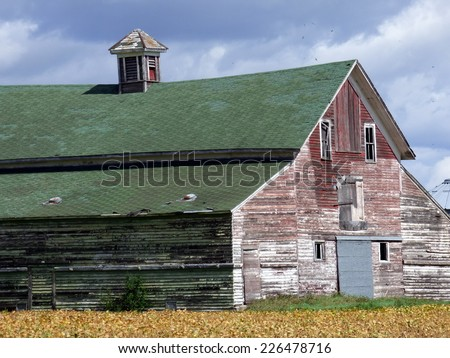 red barn with green roof - stock photo
