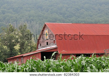 Red Barn with Quilt Block and Lush Corn Crop Horizontal with Copy Space - stock photo