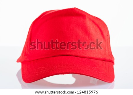 Red baseball cap on white background with reflection - stock photo