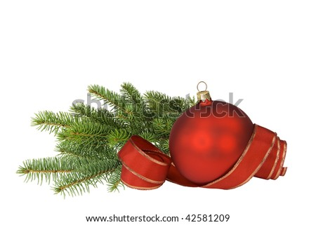 Red bauble with ribbon and branch of spruce on white. - stock photo