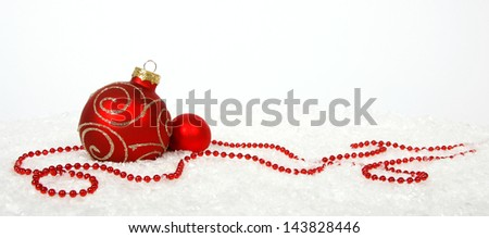Red baubles on the snow - stock photo