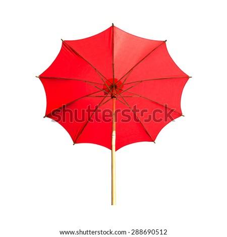 Red beach umbrella on white background. - stock photo