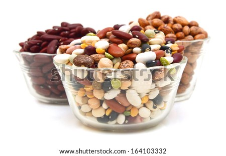 red beans and mixture of legumes in glass bowl on white  - stock photo