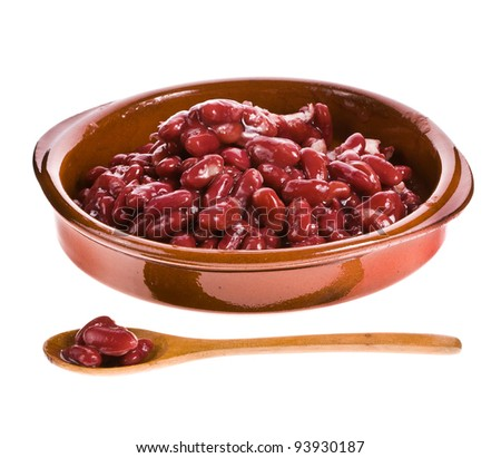 Red beans in a ceramic bowl with a wooden spoon - stock photo
