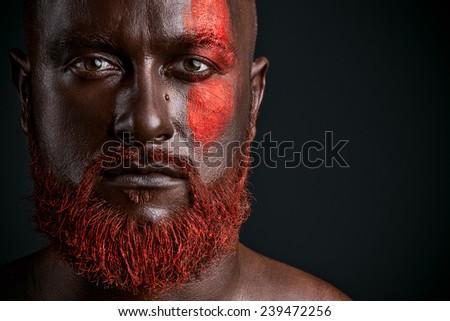 Red beard man studio portrait on dark background - stock photo
