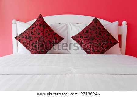 Red bedroom in a modern house - home interiors. - stock photo