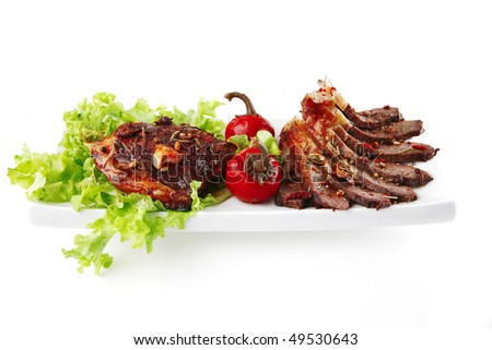red beef sliced on white ceramic with salad - stock photo