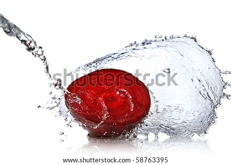 red beet with water splash isolated on white - stock photo