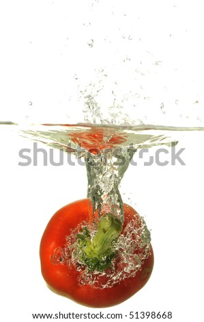 Red bell pepper splashing with bubbles in water isolated on white.