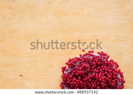 Red berries of viburnum on a plate