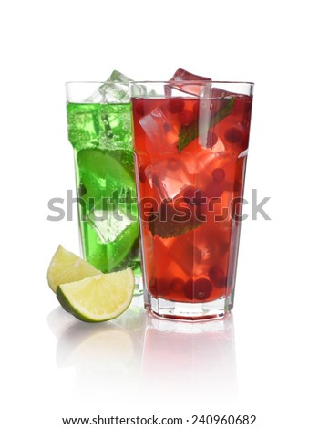 Red berry cocktail drink with cranberry and drink with lime isolated on white - stock photo