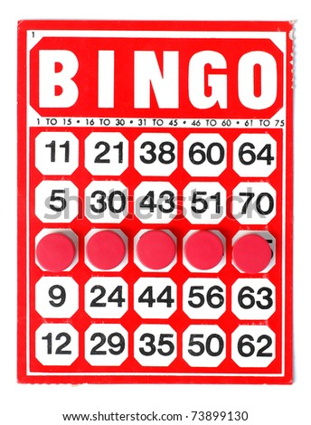 Red bingo card with winning chips - stock photo