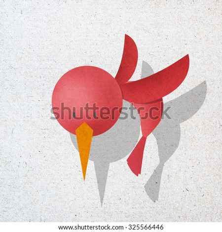Red bird in action, recycled paper craft stick on white background - stock photo