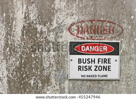 red, black and white Danger, Bush Fire Risk Zone, No Naked Flame - stock photo