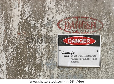 red, black and white Danger, Change warning sign with definition - stock photo