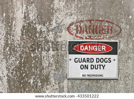 red, black and white Danger, Guard Dogs On Duty warning sign - stock photo