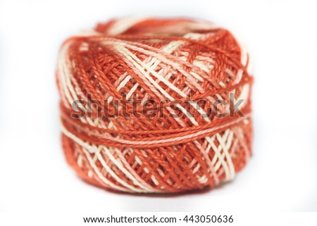 Red, black, red, lime, green and yellow sewing thread in a white background - stock photo