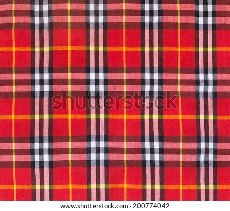 Red, black, yellow and white plaid textile fabric background. - stock photo