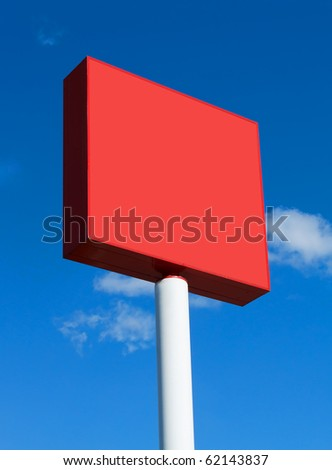 Red blank billboard on a sunny day with blue sky - stock photo