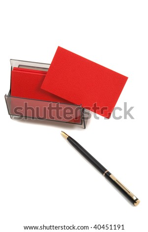 Red blank business card in holder, with pen. - stock photo
