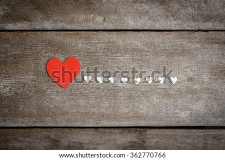 Red blank paper note with heart shape on grunge wooden background with copy space - stock photo