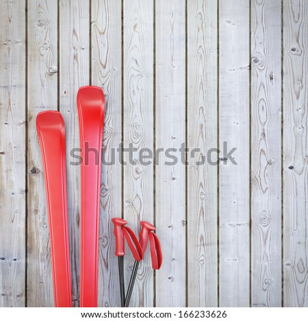 red blank skis on wooden planks wall, winter background - stock photo
