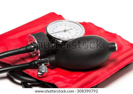 red Blood pressure cuff, close-up isolated - stock photo