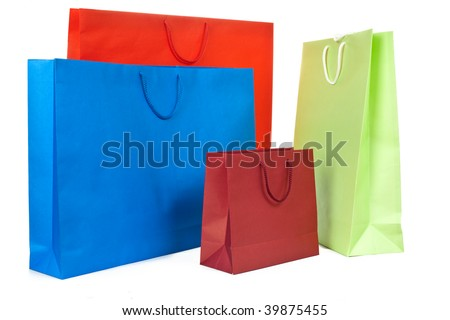 Red, blue and green paper present bags on white background - stock photo
