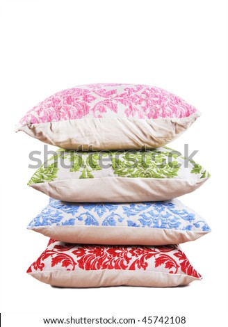 Red, blue, green and pink cushions stacked up on a pure white background with space for text - stock photo