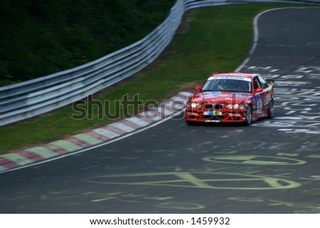 red bmw gt going in to the curve at night - stock photo