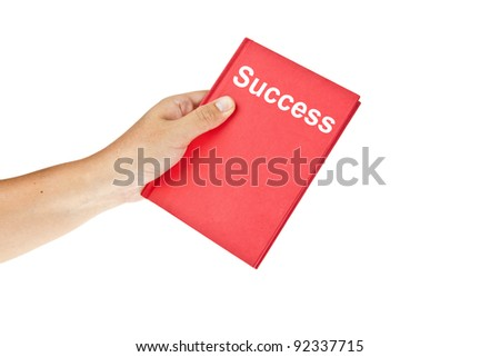 Red book of success with hand isolated on white background - stock photo