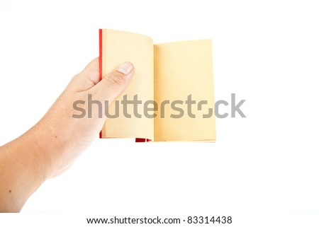 Red book open with hand isolated on white background - stock photo