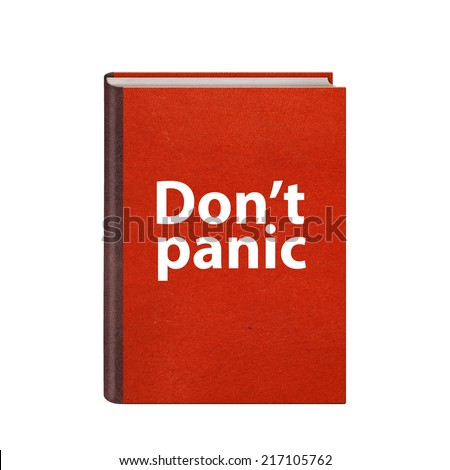 Red book with Dont panic text on cover isolated on white background - stock photo