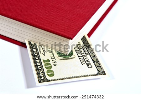 Red Book With Fictitious Hundred Dollar Bill And Shadow - stock photo